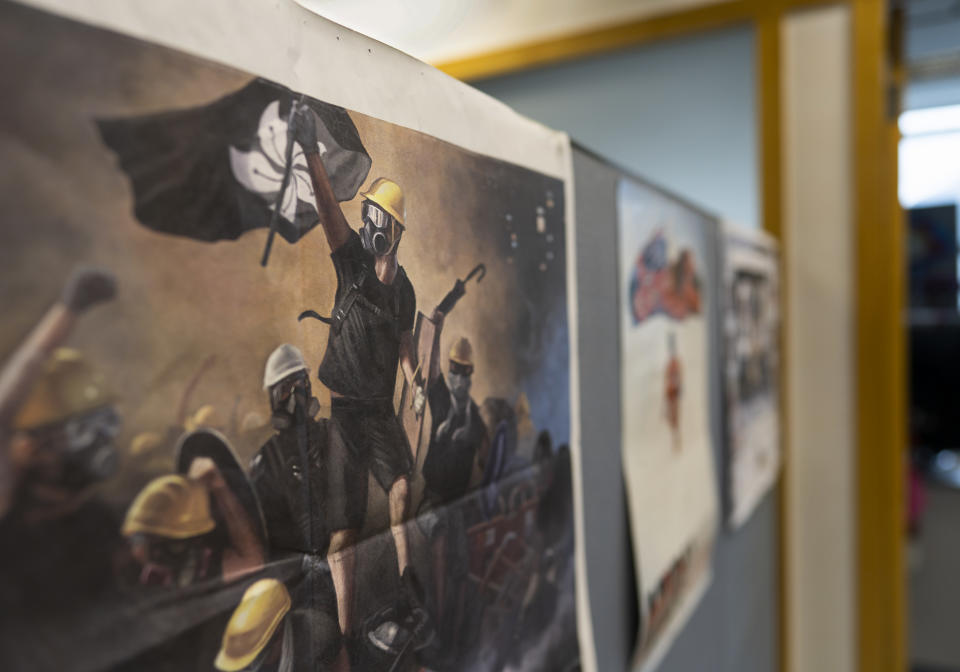 An Apple Daily poster showing a printing of the protesters is displayed at the news room of Apple Daily Monday, April 26, 2021 in Hong Kong. The Apple Daily editors and executives were detained Thursday, June 17, under a national security law that took effect last year. (AP Photo/Vincent Yu)