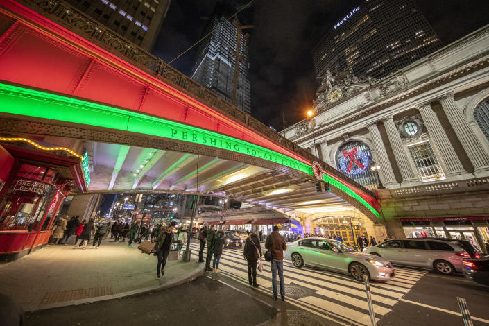 Colored lights illuminate the bridge above East 42nd Street at Pershing Square Plaza, across from Grand Central Terminal. (Photo: Gordon Donovan/Yahoo News)