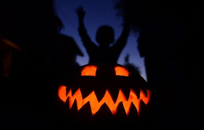 The Halloween tradition migrated in the 19th century from Britain to the United States, where immigrants found that pumpkins -- a native American fruit -- were easier to carve (AFP Photo/Frederic J. Brown)