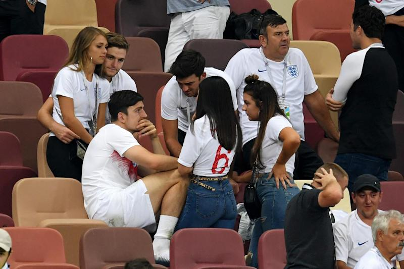 Consoling: Harry Maguire is supported by his girlfriend and family (Getty Images)