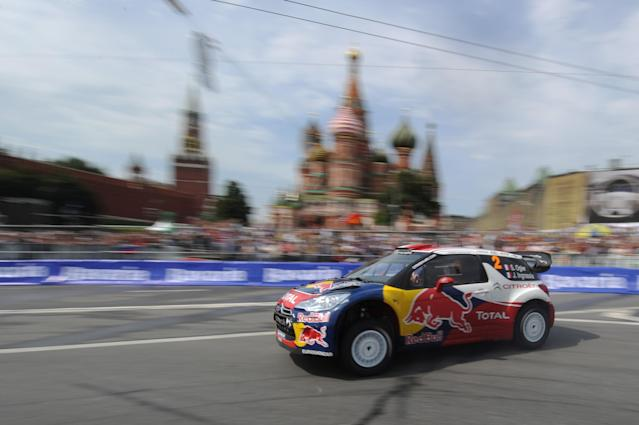 """Citroen Total World Rally team pilot Sebastien Ogier of France drives past St. Basils cathedral during the """"Moscow City Racing"""" show on July 17, 2011 in central Moscow. AFP PHOTO / NATALIA KOLESNIKOVA (Photo credit should read NATALIA KOLESNIKOVA/AFP/Getty Images)"""