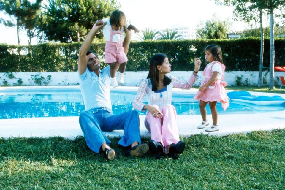 <p>Julio Iglesias joins his wife, Isabel, and their two children in the backyard of their family home in Cadiz, Spain.</p>