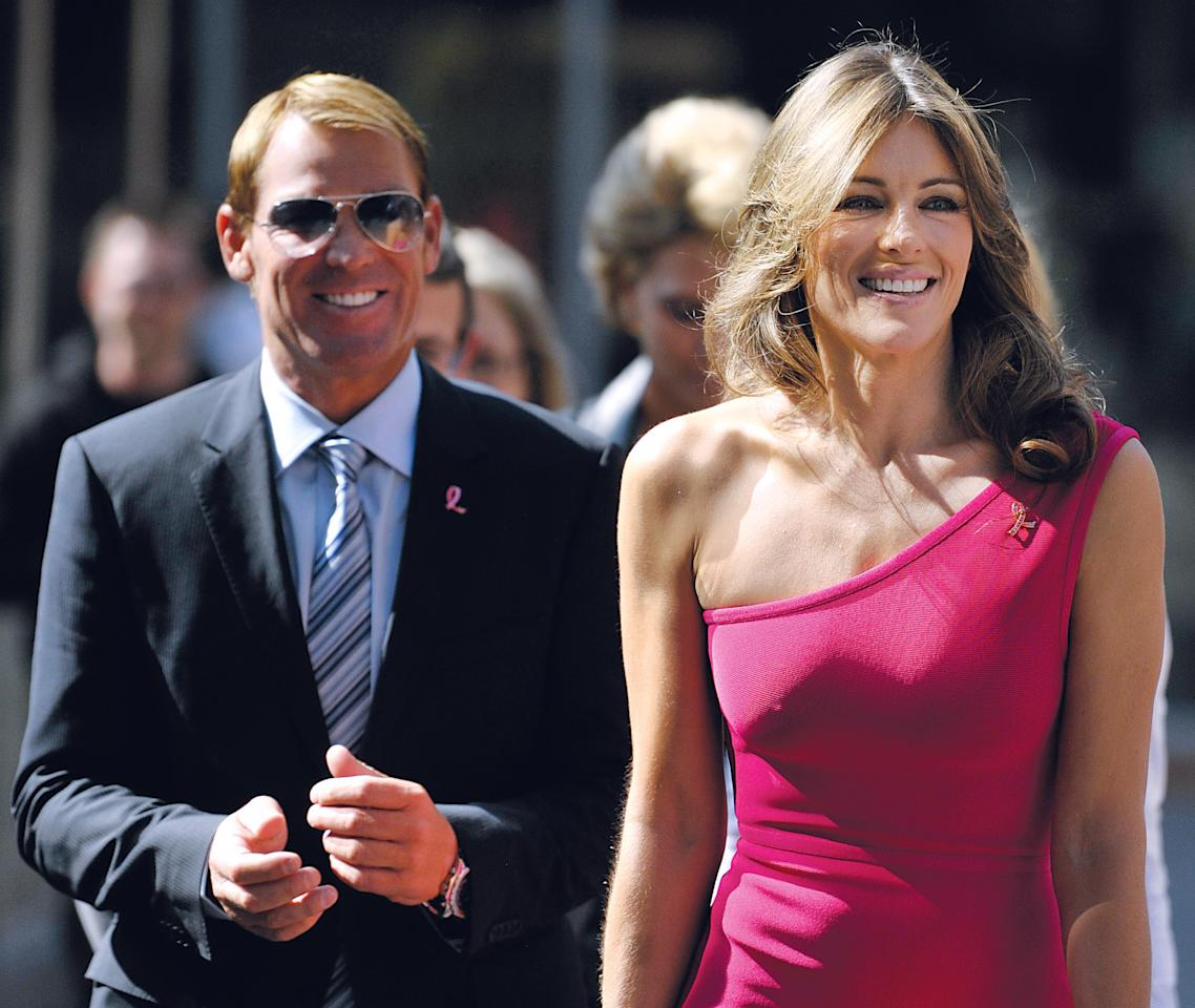 JOHANNESBURG, SOUTH AFRICA - JULY 22:  ( SOUTH AFRICA OUT) Elizabeth Hurley and her boyfriend Australian cricketer Shane Warne on July 22, 2011 in Johannesburg, South Africa. Hurley, the Estee Lauder Breast Cancer Awareness spokesmodel is in South Africa for the Est?e Lauder's Pink Illumination Ball that was held on July 21, 2011. (Photo by Foto24/Gallo Images/Getty Images)