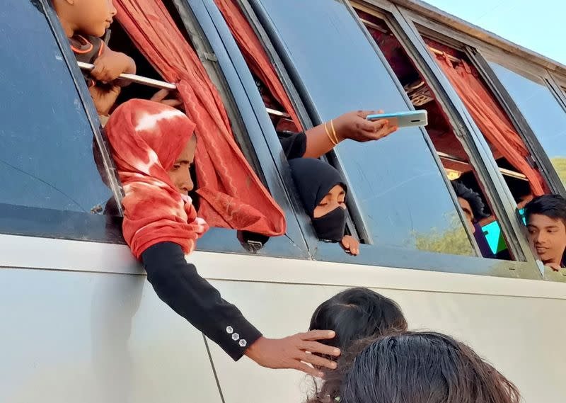Rohingyas that will be shifted to Bhasan Char island are seen on board of a bus in Cox's Bazar