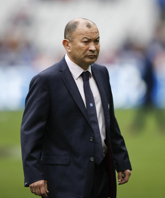 England's head coach Eddie Jones watches his team warm up prior to the start of the Six Nations rugby union match between France and England at the Stade de France stadium in Saint-Denis, outside Paris, Saturday, March 10, 2018. (AP Photo/Christophe Ena)