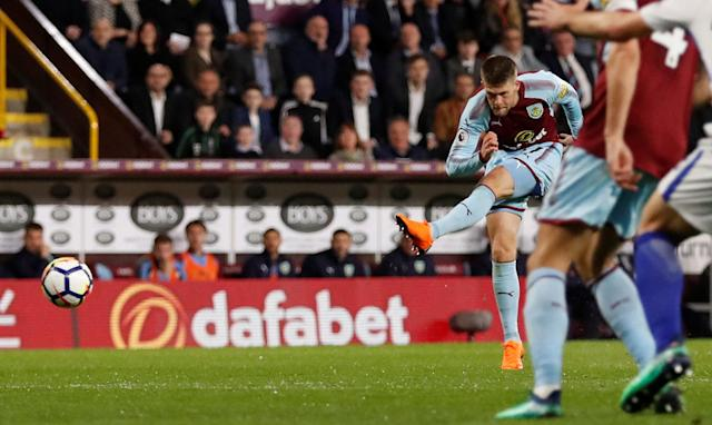"""Soccer Football - Premier League - Burnley vs Chelsea - Turf Moor, Burnley, Britain - April 19, 2018 Burnley's Johann Berg Gudmundsson shoots at goal leading to Ashley Barnes scoring their first goal Action Images via Reuters/Andrew Boyers EDITORIAL USE ONLY. No use with unauthorized audio, video, data, fixture lists, club/league logos or """"live"""" services. Online in-match use limited to 75 images, no video emulation. No use in betting, games or single club/league/player publications. Please contact your account representative for further details."""