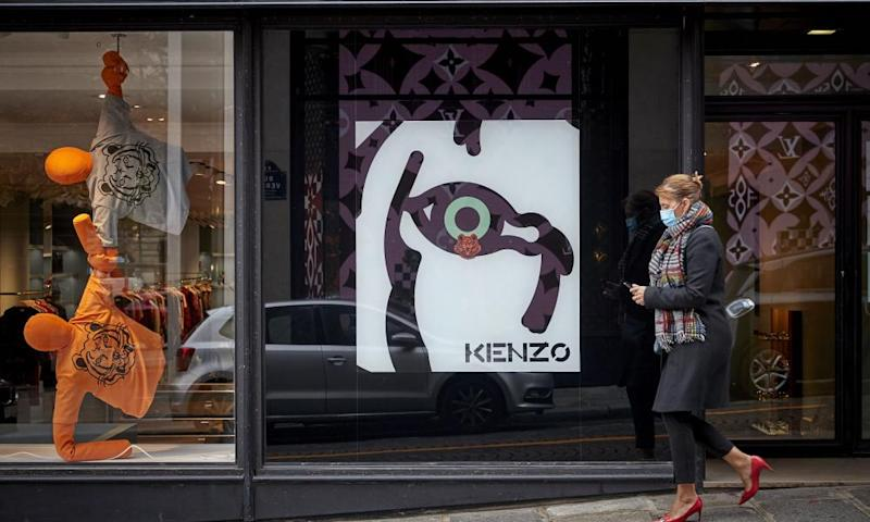 A Parisian walks past the flagship Kenzo store near the Champs Elysees.