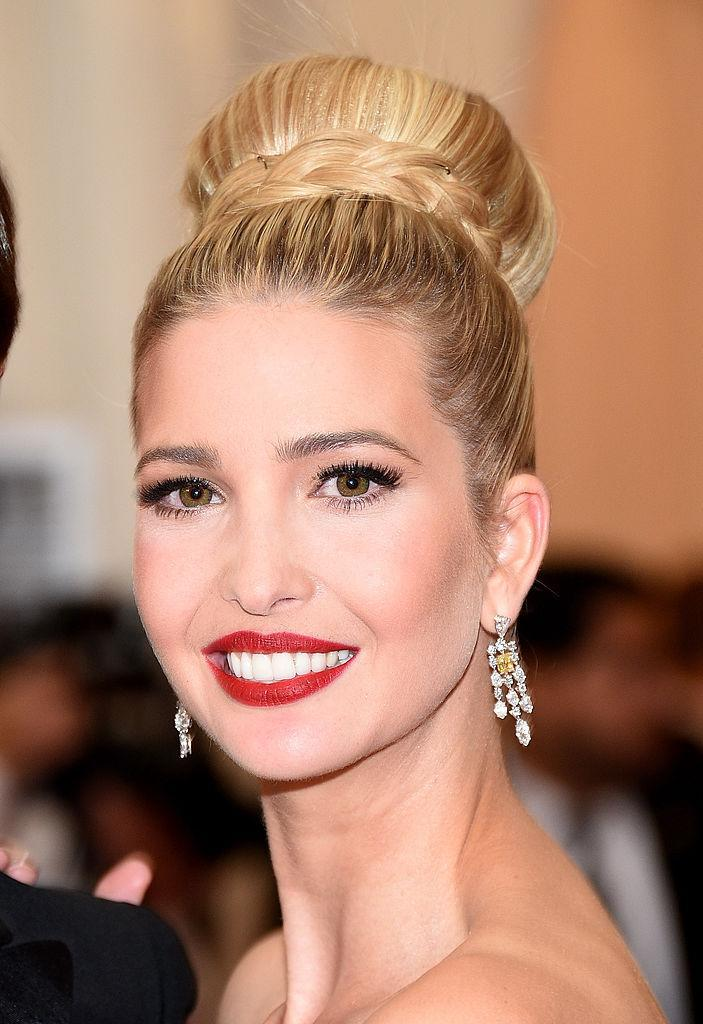 <p>Ivanka wore a tight, high-braided bun to the Met Gala with dramatic matte red lips. (Photo: Getty Images) </p>