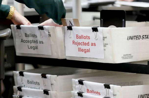 PHOTO: Boxes for Vote-by-Mail ballots that have been rejected or accepted due to signature discrepancies are set up at the Miami-Dade County Elections Department in Doral, Fla., Oct. 15, 2020. (Joe Raedle/Getty Images)