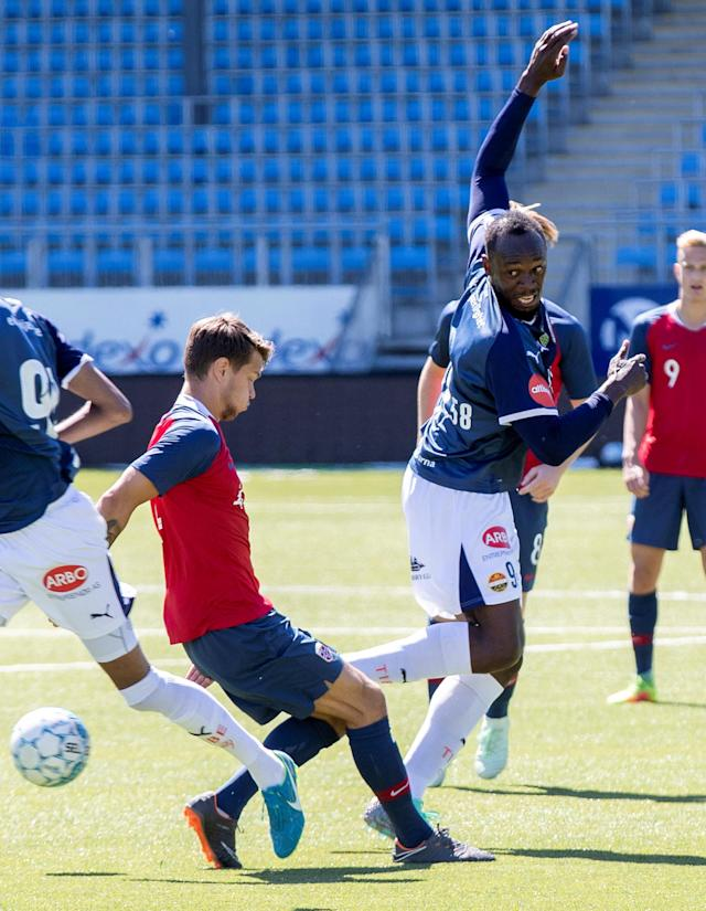 Jamaican sprint legend Usain Bolt and Norway's U19 player Tord Johnsen Salte play in a friendly football match between Stromsgodset and Norway's U19 team at Marienlyst Stadium in Drammen, Norway, June 5, 2018. NTB Scanpix/Vidar Ruud via REUTERS ATTENTION EDITORS - THIS IMAGE WAS PROVIDED BY A THIRD PARTY. NORWAY OUT. NO COMMERCIAL OR EDITORIAL SALES IN NORWAY.