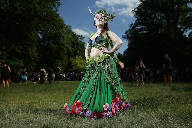 "<p>A young woman who said her creation of her outfit, inspired by nature, just ""grew and grew and grew"", attends the Victorian Picnic on the first day of the annual Wave-Gotik-Treffen (WGT) Goth music festival on June 2, 2017 in Leipzig, Germany. (Sean Gallup/Getty Images) </p>"
