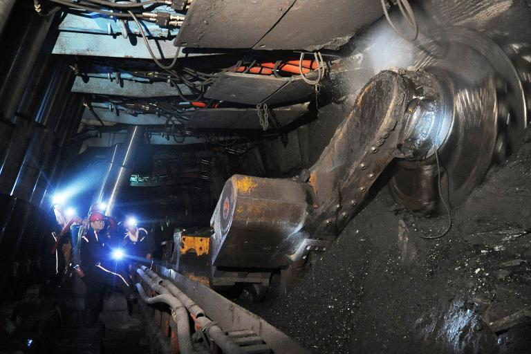 Laborers work at a coal mining facility in Huaibei, in northern China's Anhui province, on March 4, 2014