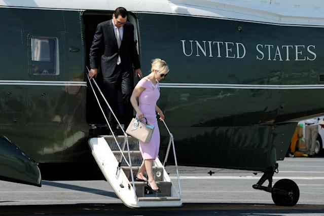 Treasury Secretary Steve Mnuchin and his wife, Louise Linton, arrive on the Marine One helicopter with President Trump aboard the deck of the aircraft carrier USS Gerald R. Ford for its commissioning ceremony at Naval Station Norfolk in Norfolk, Va., July 22, 2017. (Photo: Jonathan Ernst/Reuters)