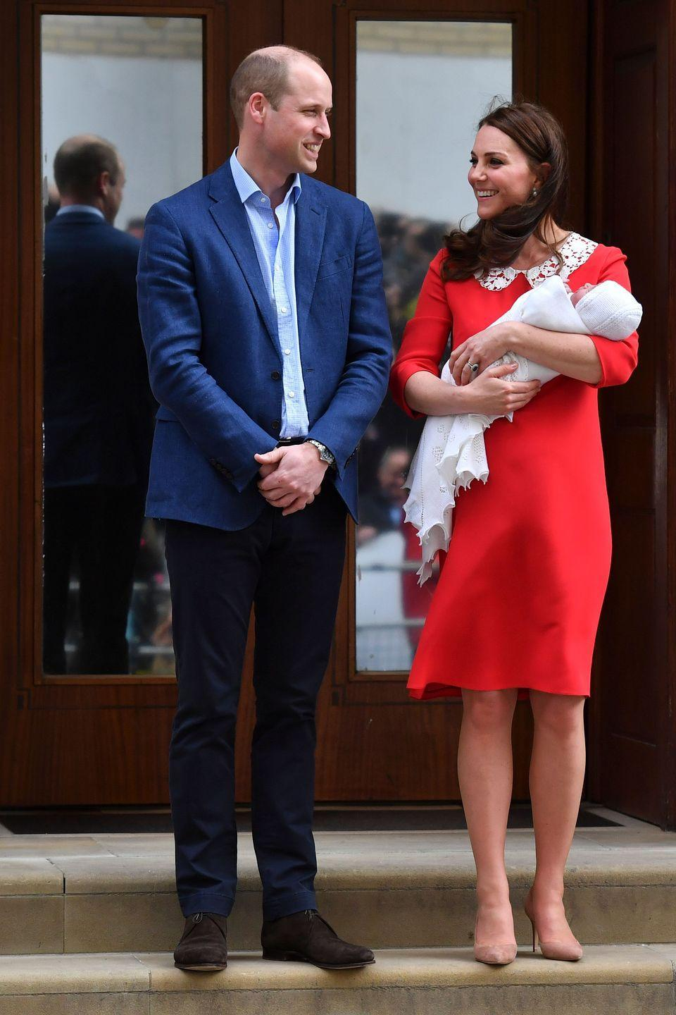 """<p>The Duchess of Cambridge introduced baby number three to <a href=""""https://www.townandcountrymag.com/society/tradition/a19675070/kate-middleton-third-baby-lindo-wing-outfit/"""" rel=""""nofollow noopener"""" target=""""_blank"""" data-ylk=""""slk:the world wearing a custom Jenny Packham dress"""" class=""""link rapid-noclick-resp"""">the world wearing a custom Jenny Packham dress</a>, complete with a chic peter pan collar. The Duchess accessorized with a pair of Gianvito Rossi heels. </p>"""