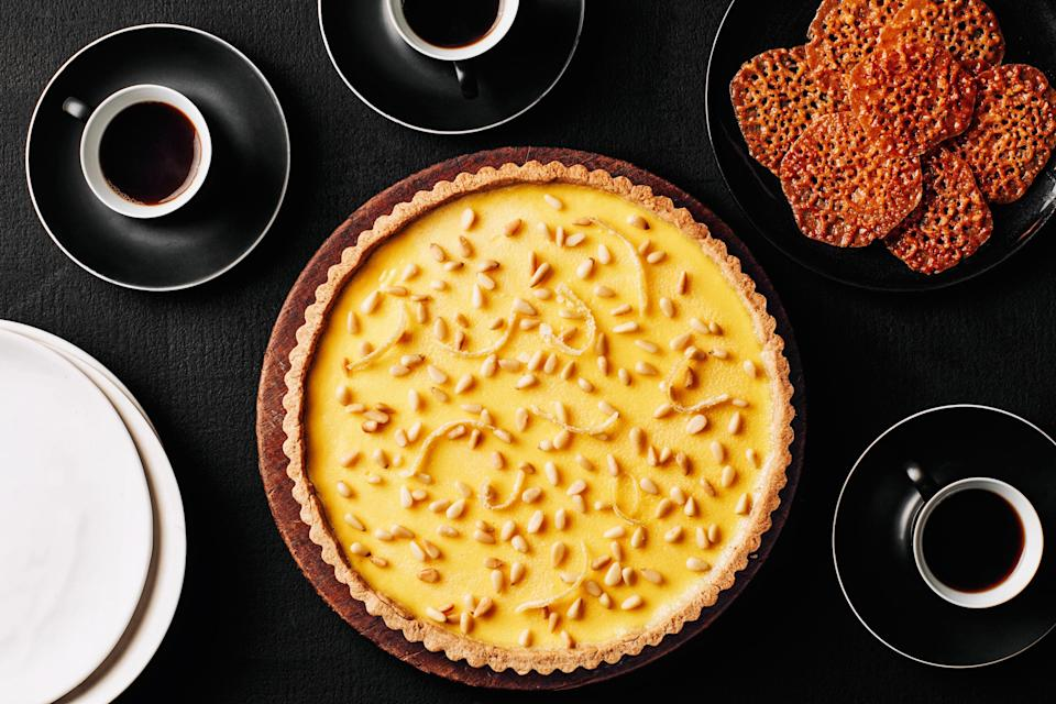 "Add a blast of bright citrus to your holiday with this Italian-style tart. Store any leftover pine nuts in your freezer to keep them at peak freshness. <a href=""https://www.epicurious.com/recipes/food/views/rustic-lemon-tart-torta-della-nonna-al-limone-with-pine-nut-lace-cookies?mbid=synd_yahoo_rss"" rel=""nofollow noopener"" target=""_blank"" data-ylk=""slk:See recipe."" class=""link rapid-noclick-resp"">See recipe.</a>"