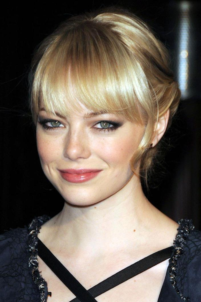 <p>Emma occasionally goes back to blonde, her real color, and while she experiments with tones and shades, it's this light honey hue that comes naturally.</p>