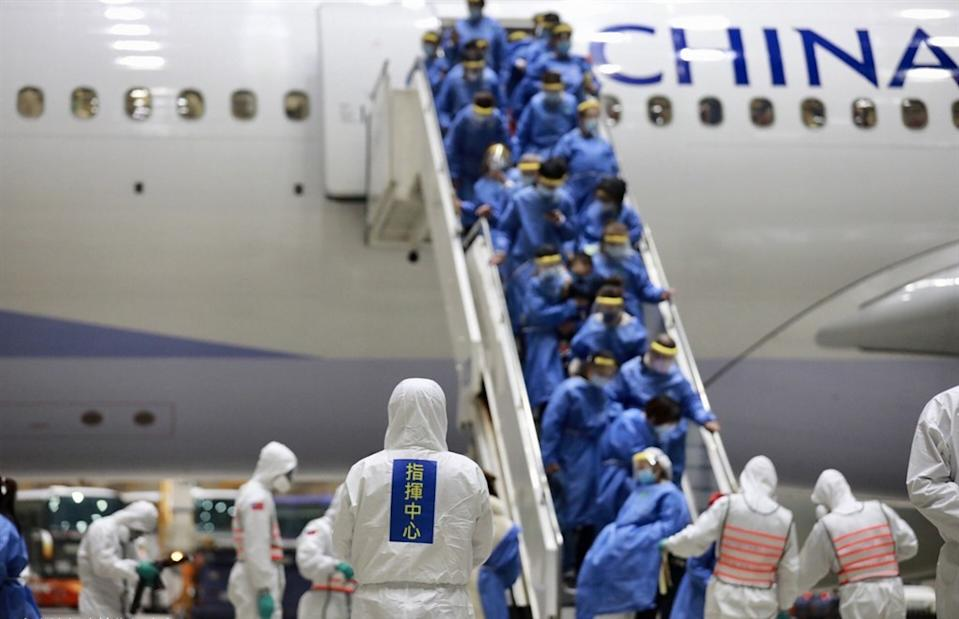 Passengers disembark from a China Airlines rescue flight from Wuhan, China in this file photo. (Courtesy of the CECC)
