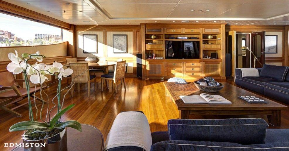 """<p>Designer Michael Leach's interiors swap out the heavy wood for light, creating a cheerful living area that feels like home — even on the ocean. After a long day on the water, it's an ideal spot to hide away with a book.</p><p>Find more details about the Azteca II <a href=""""http://www.edmiston.com/luxury-yachts-for-sale/azteca-ii-1105/"""" target=""""_blank"""">here</a>.</p>"""