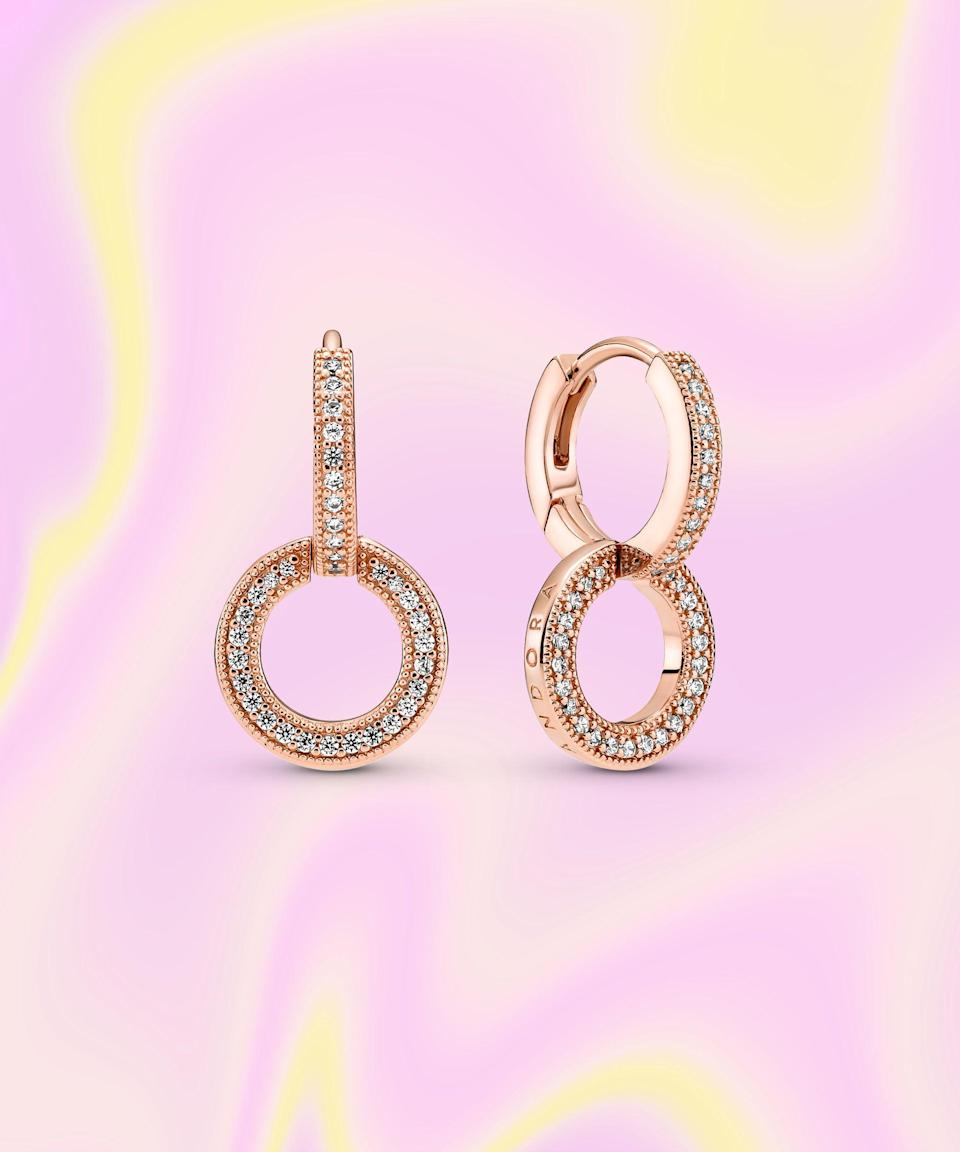 """<br><br><strong>PANDORA</strong> Sparkling Double Hoop Earrings, $, available at <a href=""""https://go.skimresources.com/?id=30283X879131&url=https%3A%2F%2Fus.pandora.net%2Fen%2Fcollections%2Fpandora-signature%2Fsparkling-double-hoop-earrings%2F289052C01.html%3Fcgid%3Ddiscover-collections-pandora-signature"""" rel=""""nofollow noopener"""" target=""""_blank"""" data-ylk=""""slk:PANDORA"""" class=""""link rapid-noclick-resp"""">PANDORA</a>"""