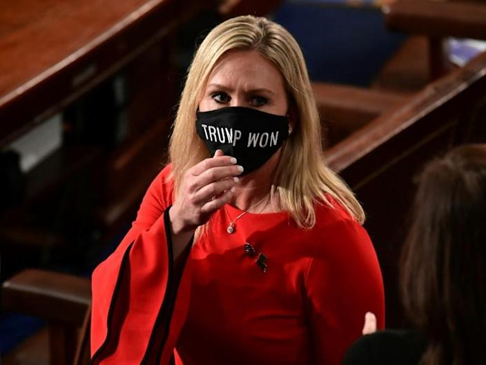 "Marjorie Taylor Greene wears a ""Trump Won"" face mask as she arrives to take her oath of office as a newly elected member of the House of Representatives"
