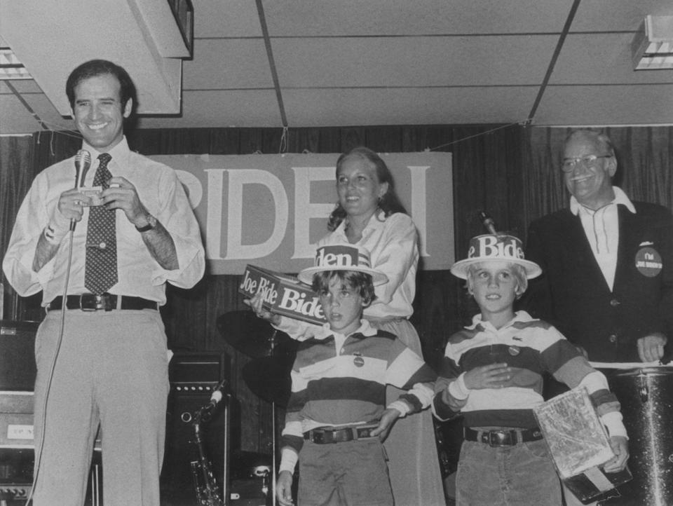 Biden stands on stage with his wife, Jill, and sons Hunter, left, and Beau, along with his father, Joe Biden Sr., during a campaign event in 1988.