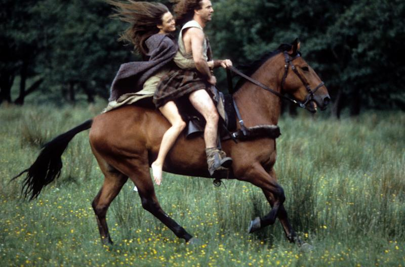 Catherine McCormack and Mel Gibson on horseback together in a scene from the film 'Braveheart', 1995. (Photo by 20th Century-Fox/Getty Images)