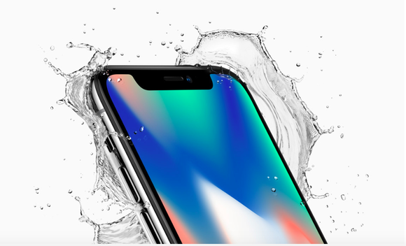Apple's iPhoneX is shown with splashing water around it in a glossy advertisement photo