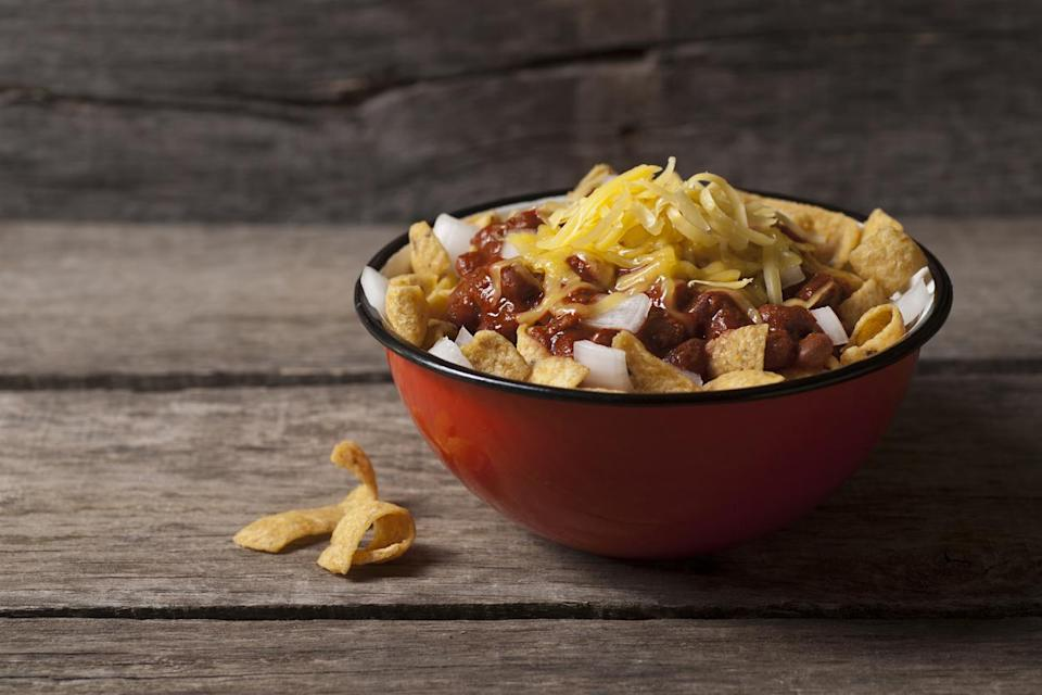 "<p>Although there is fierce debate between Texas and New Mexico over who can rightly lay claim to Frito pie, The Five & Dime General Store in Santa Fe, New Mexico, has been serving the dish since the 1960s. The <a href=""https://www.thedailymeal.com/make-ahead-meals-you-can-freeze?referrer=yahoo&category=beauty_food&include_utm=1&utm_medium=referral&utm_source=yahoo&utm_campaign=feed"" rel=""nofollow noopener"" target=""_blank"" data-ylk=""slk:hearty comfort dish"" class=""link rapid-noclick-resp"">hearty comfort dish</a> is best eaten directly from a bag of chips. That's right, <a href=""https://www.thedailymeal.com/recipes/big-game-fritos-pie-recipe?referrer=yahoo&category=beauty_food&include_utm=1&utm_medium=referral&utm_source=yahoo&utm_campaign=feed"" rel=""nofollow noopener"" target=""_blank"" data-ylk=""slk:Frito pie is made"" class=""link rapid-noclick-resp"">Frito pie is made</a> by simply pouring in a ladleful of your favorite chili recipe and topping it with cheese and onions.</p>"