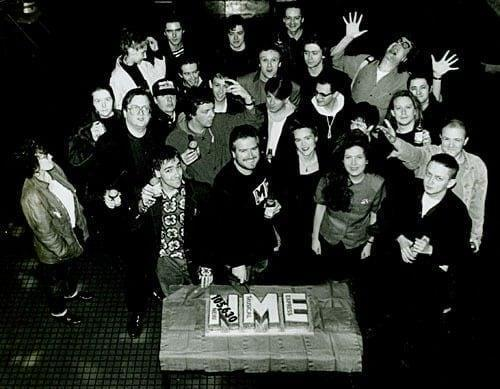 Lewis with the NME staff in the late 1980s celebrating a rise in circulation
