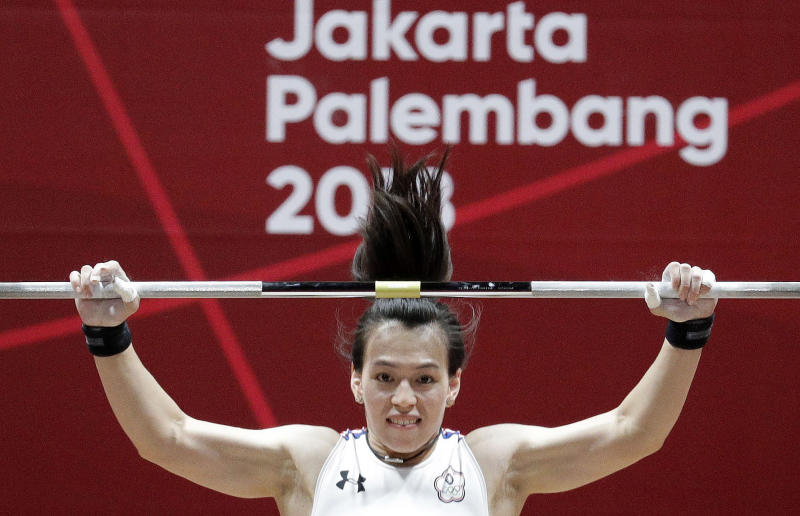 Gold medalist Taiwan's Hsingchun Kuo makes her attempt during the women's 58kg weightlifting at the 18th Asian Games in Jakarta, Indonesia, Thursday, Aug. 23, 2018. Kuo placed gold. (AP Photo/Aaron Favila)