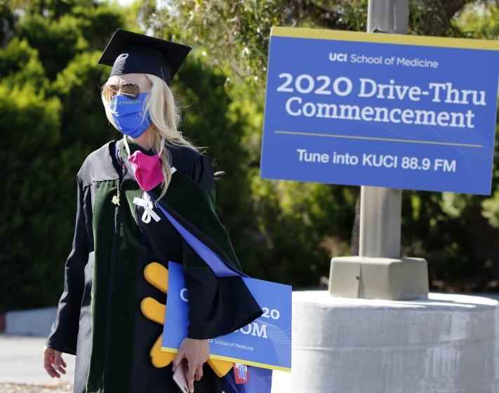 Associate Dean for Students Megan Osborn walks the parking lot before the University of California, Irvine, School of Medicine class of 2020 first ever drive-thru commencement ceremony at the school in Irvine on Saturday, May 30, 2020.