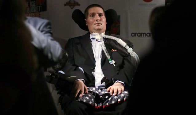 Pete Frates listens to a guest during an event at Fenway Park in Boston in June. Frates died on Monday after a seven-year battle with ALS. (AP)