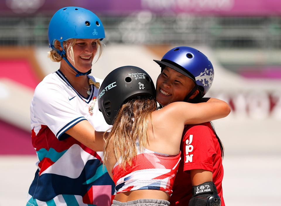 TOKYO, JAPAN - AUGUST 04: Sky Brown of Team Great Britain hugs Sakura Yosozumi of Team Japan during the Women's Skateboarding Park Finals on day twelve of the Tokyo 2020 Olympic Games at Ariake Urban Sports Park on August 04, 2021 in Tokyo, Japan. (Photo by Ezra Shaw/Getty Images)