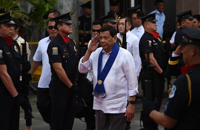 Rodrigo Duterte came to power in the Philippines after promising to kill drug dealers - he now faces an initial probe by the International Criminal Court (AFP Photo/TED ALJIBE)