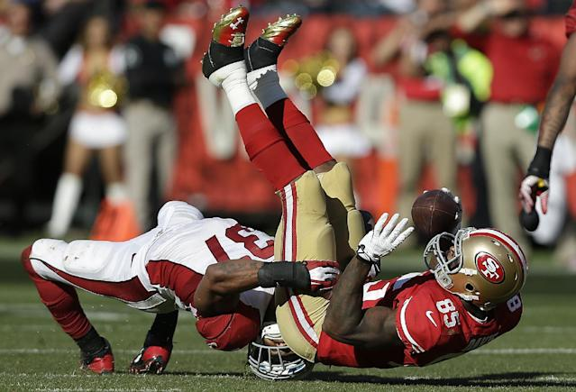 San Francisco 49ers tight end Vernon Davis (85) is tackled by Arizona Cardinals strong safety Yeremiah Bell (37) during the fourth quarter of an NFL football game in San Francisco, Sunday, Oct. 13, 2013. (AP Photo/Marcio Jose Sanchez)