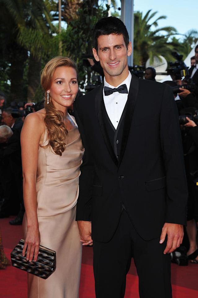 """CANNES, FRANCE - MAY 17: Tennis player Novak Djokovic (R) and Jelena Ristic attends """"The Beaver"""" premiere at the Palais des Festivals during the 64th Cannes Film Festival on May 17, 2011 in Cannes, France. (Photo by Pascal Le Segretain/Getty Images)"""
