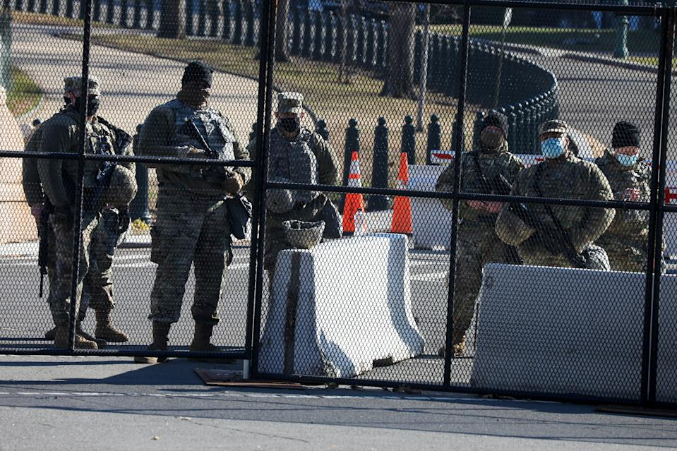 Members of the National Guard are issued weapons outside the US Capitol Wednesday. Source: Getty