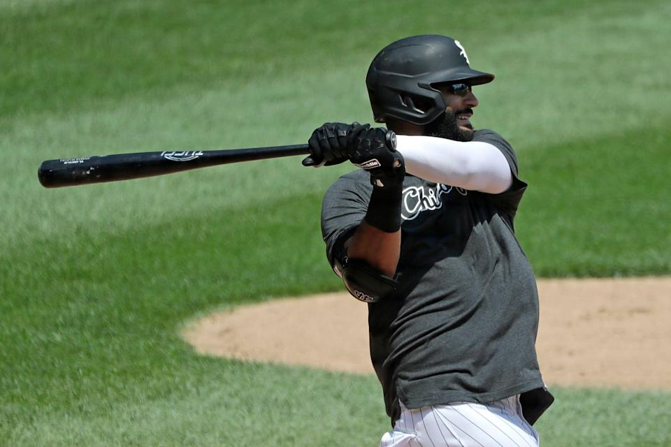 FILE - In this July 9, 2020, file photo, Chicago White Sox's Nomar Mazara hits during baseball practice at Guaranteed Rate Field in Chicago. Mazara and the Detroit Tigers finalized a $1.75 million, one-year contract on Friday, Feb. 12, 2021. (AP Photo/Nam Y. Huh, File)