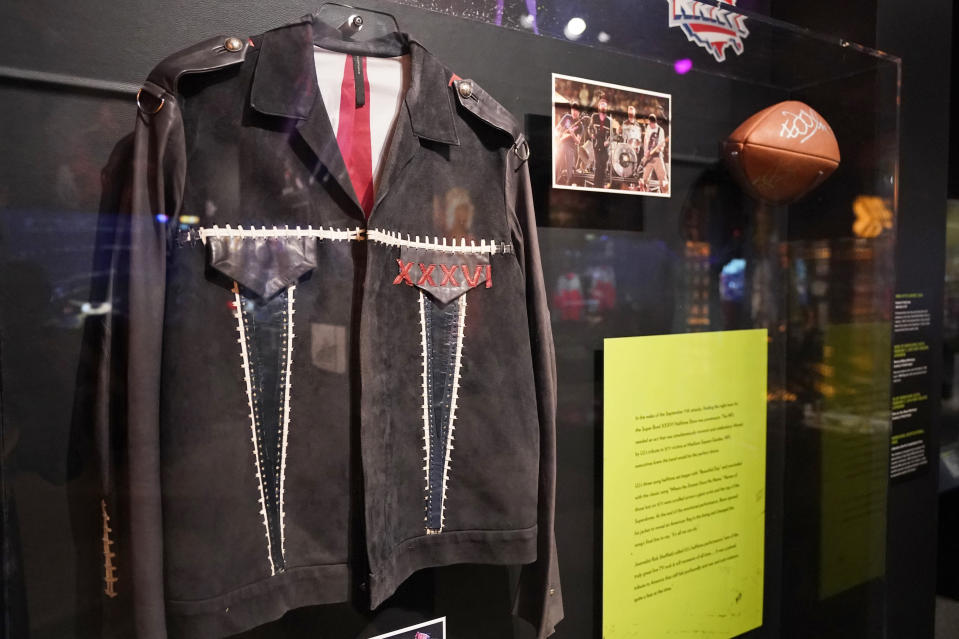 A jacket worn by U2's Bono is on display Thursday, April 29, 2021 at the Rock and Roll Hall of Fame in Cleveland. Bono wore this jacket during the band's performance at Super Bowl's XXXVI Half Time show on Feb. 2, 2002. Rock Hall's NFL Halftime Show Exhibit with 55 Years Of NFL Halftime Shows, runs from April to September. (AP Photo/Tony Dejak)