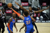 Oklahoma City Thunder forward Isaiah Roby (22) takes a shot against center Serge Ibaka, right, during the third quarter of an NBA basketball game Sunday, Jan. 24, 2021, in Los Angeles. (AP Photo/Ashley Landis)
