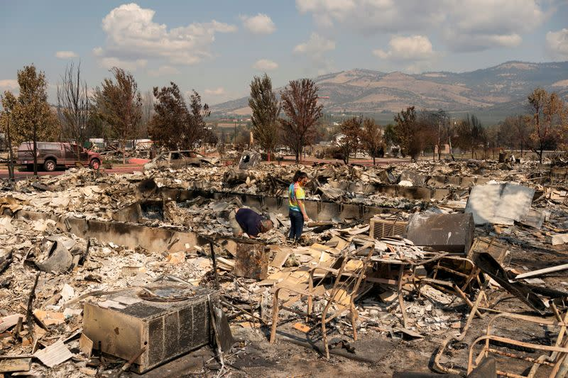 Firefighters in U.S. northwest aided by weather, as winds drive California blaze