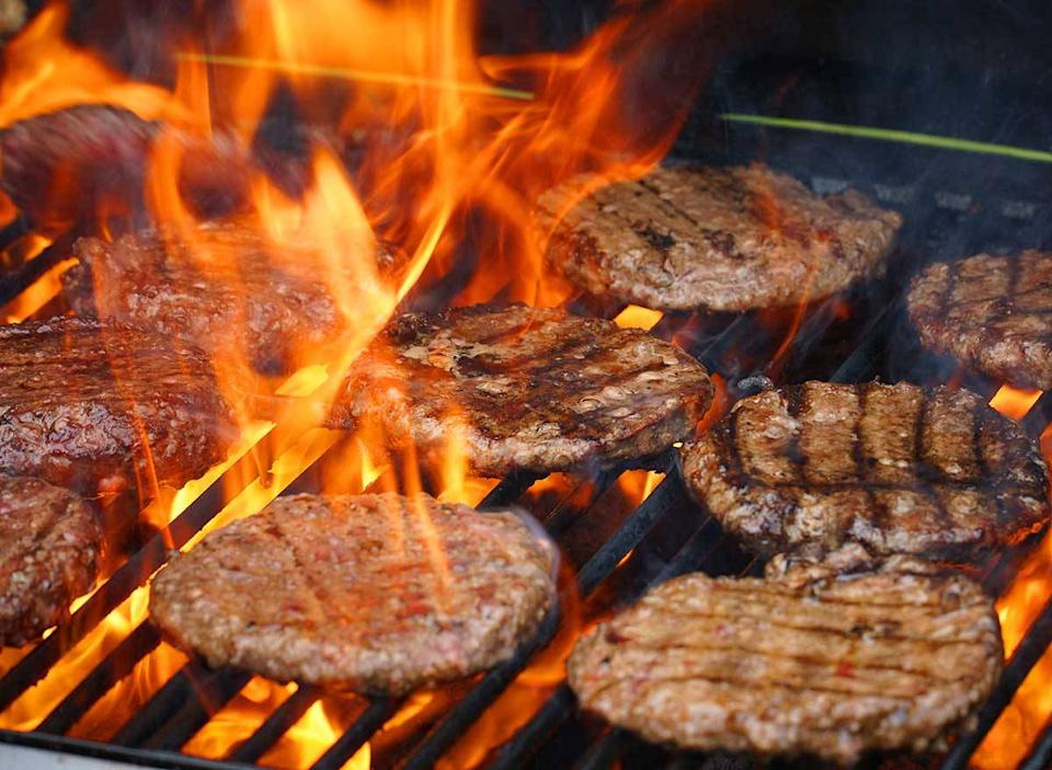 scorching burgers over an open flame