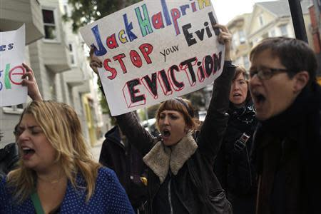 Demonstrators shout during a rally in the Mission neighborhood in San Francisco