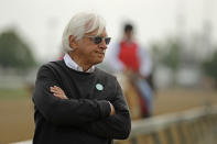 "FILE - In this May 1, 2019, file photo, trainer Bob Baffert watches his Kentucky Derby entrant Game Winner during a workout at Churchill Downs in Louisville, Ky. Two-time Triple Crown-winning trainer Bob Baffert, who has had multiple horses test positive in post-race drug testing, is taking steps to ""do better,"" including hiring outside oversight. Baffert said in a statement Wednesday, Nov. 4, 2020, that he is ""very aware"" of the incidents involving his horses and the impact that it's had on his family, the sport and himself. (AP Photo/Charlie Riedel)"