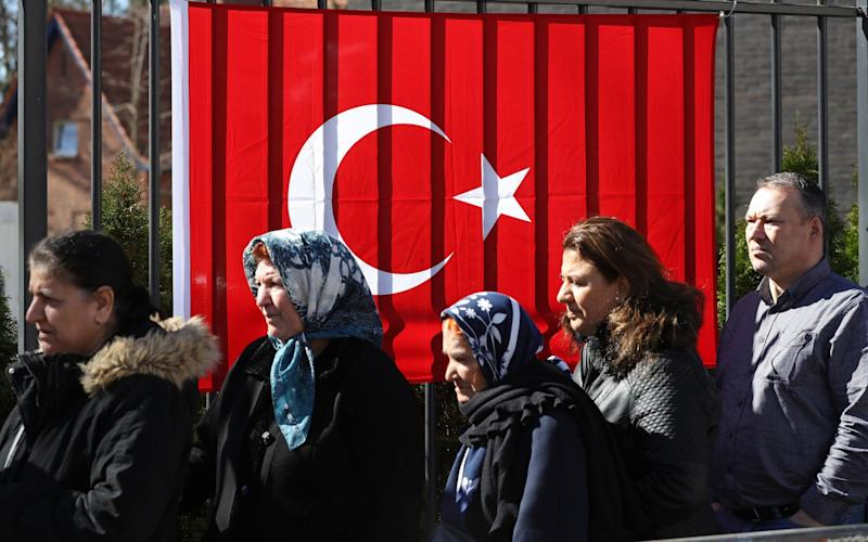 Turkish citizens line up outside the Turkish consulate to cast their votes in the Turkish referendum in Berlin - Getty Images Europe