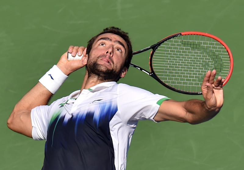 Marin Cilic of Croatia serves to Tomas Berdych of the Czech Republic during their 2014 US Open men's quarterfinal singles match at the USTA Billie Jean King National Tennis Center September 4, 2014 in New York (AFP Photo/Stan Honda)