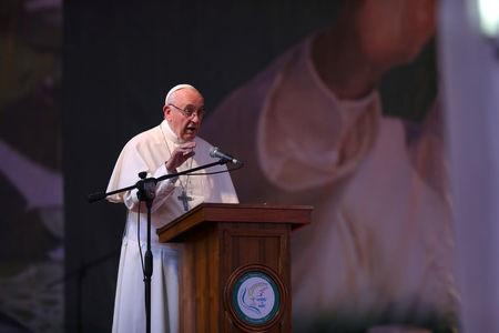 Pope Francis speaks during a visit to the Notre Dame College in Dhaka