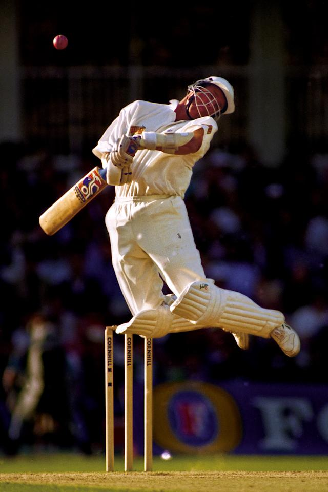 "Alec Stewart of England avoids a bouncer from Wasim Akram of Pakistan during the 3rd test match England versus Pakistan at the Oval cricket ground on August 25th in Kennington, London 1996 (Photo by Tom Jenkins/Getty Images). An image from the book ""In The Moment"" published June 2012"
