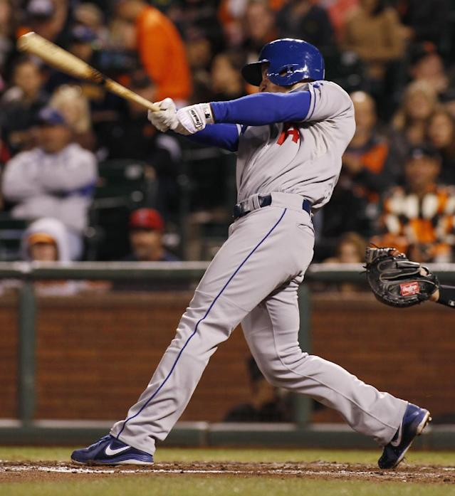 Los Angeles Dodgers' Mark Ellis hits an RBI-double against the San Francisco Giants during the fourth inning of a baseball game in San Francisco, Thursday, Sept. 26, 2013. (AP Photo/George Nikitin)