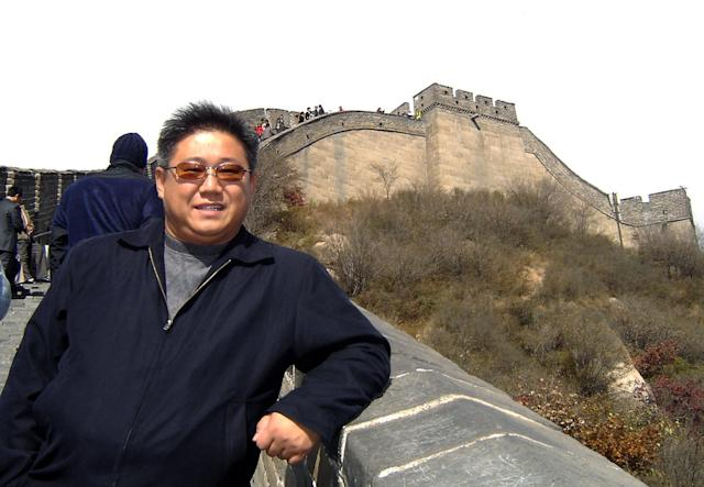 In this undated photo provided by the family of Kenneth Bae, Kenneth Bae, poses for a photo in China, where he used to live. Bae, a 45-year-old tour operator and Christian missionary was arrested last November while leading a group of tourists in the northeastern region of Rason in North Korea and has been detained for the past 11 months. Bae's family said on Thursday, Oct. 10, 2013, that Bae's mother, Myunghee Bae, is being allowed to visit him. (AP Photo/Courtesy Terri Chung)